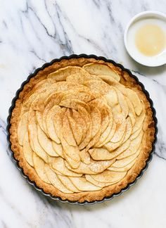 This delicious apple tart features an easy crust made with almond and oat flour. It's gluten free and easily made vegan/dairy free, too! Post sponsored by @bobsredmill. cookieandkate.com