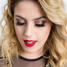 Despite conventional wisdom, you don't need to choose between playing up your eyes and your lips. This is the season to go a little more glam that usual, after all! Get the tutorial on Miss Laur »  - GoodHousekeeping.com
