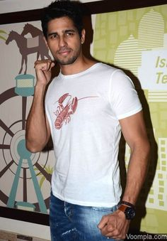 Sidharth Malhotra shows off his lean body in a white T-shirt and jeans. via Voompla.com