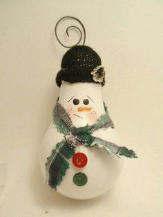 Snowman Light Bulb Ornament by brightideasbylorrie on Etsy Snowman Crafts, Christmas Projects, Decor Crafts, Holiday Crafts, Christmas Crafts, Painted Ornaments, Handmade Ornaments, Xmas Ornaments, Lightbulb Ornaments