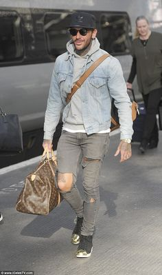 Trendy: Meanwhile Pete wore ripped jeans, grey hoodies and a denim jacket, while he held o...
