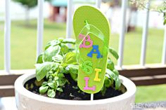 Use flip flops for garden markers in the summer! What a cute idea to make the garden more playful!