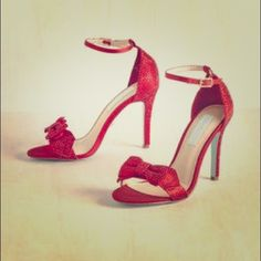 Modcloth Operatic Elegance Heel in Ruby Gorgeous red pumps with crimson rhinestones, ankle strap, and decorative bow. Heels are 4 inches. By Betsey Johnson. Discontinued style. ModCloth Shoes Heels