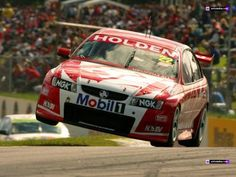 Really cool pic of a Holden getting some air in the V8 Supercar Series