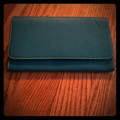 Teal never been used wallet! Teal wallet with ID slot and 11 credit card slots with change pocket and room for cash and receipts Bags Wallets