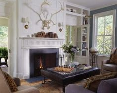 Fernhill - traditional - family room - dc metro - Neumann Lewis Buchanan Architects Family portrait instead of Caribou antlers Plus family heirlooms on shelving and this becomes a perfect room . in my humble opinion Love the blue wall Traditional Family Rooms, Living Room Decor Traditional, Home Decor Styles, Diy Home Decor, Heart Pine Flooring, Fireplace Mantels, Fireplaces, Library Fireplace, Fireplace Ideas