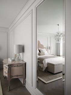I like the border on the rug in this bedroom. This luxurious Swiss chalet has been completely redesigned by the renowned interior designer Kelly Hoppen.