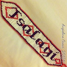 Tsalagi (the word 'Cherokee' in the language) beaded bracelet   (square stitch; seed beads)
