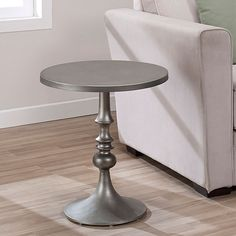 Add sleek style to your home decor with this gray-steel accent table. With a hammer-tone powder coat finish, this scratch and mar-resistant 100 percent metal table features a circular top and an elegantly designed turned pedestal base.
