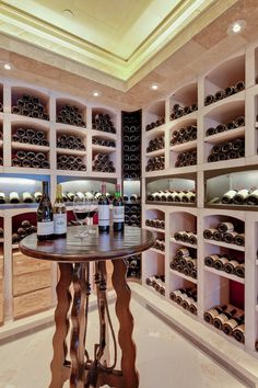 Lots of wine storage with a cute tasting table.  Darling!