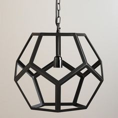 Bringing contemporary flourishes to vintage industrial style, our exclusive pendant light is crafted in India of metal with an aged black finish in a honeycomb design. This open pendant's geometric contours make it a great match with our vintage-style Edison filament bulb.