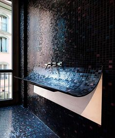 Contemporary bathroom sinks created with mosaic tiles in dark colors