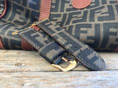 handmade Watch strap by VINTAGE FENDI bag   100% authentic MATERIALS WELCOME AUTHENTICATION TEST !!!!  This is not a licensed FENDI , product, it is handcrafted w/care from a legally purchased FENDI , item material.   is not affilated with or sponsored by FENDI    Comes with BUCKLE AND