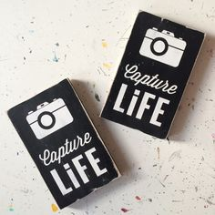 "Limited edition small size Capture Life hand painted sign.   Black with weather worn white letters.      Great for your gallery wall or to display with pictures on a shelf.     9"" X 5.5"" X .75""    sign will ship in two weeks.  