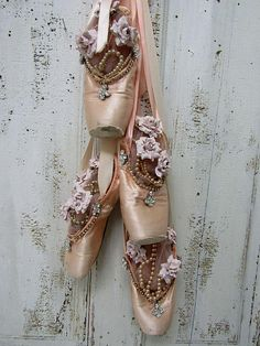Pink worn ballet point shoes wall hanging shabby cottage chic faded slippers embellished millinery rose and pearls home decor anita spero design This is a cluster of worn vintage ballet pointe shoes- I clustered them together and embellished the top of the ribbon with antique/vintage