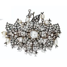 Pearl and Diamond Flower Brooch, French, circa 1850 Designed as a spray of flowers and leaves set throughout with numerous old-mine and rose-cut diamonds, altogether weighing approximately 30.00 carats, the central blossom set with a pearl measuring approximately 13.4 by 12.1 mm., further decorated throughout with 10 additional pearls of baroque and pear shape, mounted in gold and silver, 2 diamonds missing.