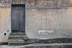 Old Sandstone And Brick Wall With Wooden Door Pealing Paint And ...