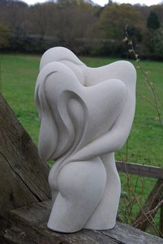 Hand made marble/ mineral stone Abstract Contemporary or Modern Outdoor Outside Exterior Garden / Yard Sculptures Statues statuary sculpture by artist Jo Ansell titled: 'Entwined- (Embrace Carved marble Lovers Contemporary sculpture statue)'
