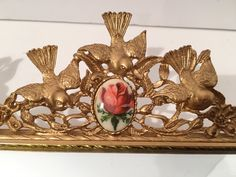 A personal favorite from my Etsy shop https://www.etsy.com/listing/270180041/vintage-ormolu-ornate-filigree-love