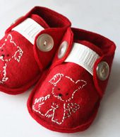 Tiny red dog shoes