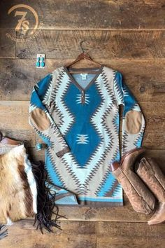 The Layton - Soft blanket sweater dress. Suede elbow patches. Southwest knit sweater material. V-neck with button detail. Cowgirl style. Rodeo fashion. Women's Western Wear. Ranch style. https://savannahsevens.com/collections/dresses/products/the-layton