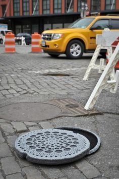Manhole cover by Nathan Vincent.