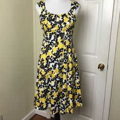 """London Times dress London Times floral patterned dress. Pin tuck pleated neckline, fit and flare. Gently used. Lined breast area. 97% Cotton, 3% Spandex. Chest pit to pit 32"""". Smallest part of the waist is 14.5 across.  Length 38"""". London Times Dresses"""