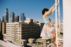 Very cute ladder picture, love the dress