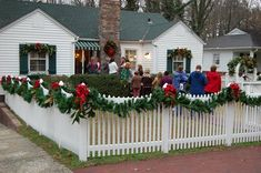 White Picket fence for Christmas - Get the one shaped like draped garland or straight across