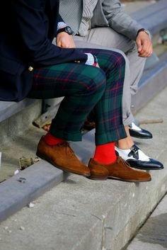 Tartan plaid pant, navy blue gold button blazer, bright red socks and suede oxfords. Awesome!