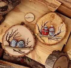 Painted rocks on wood slices.