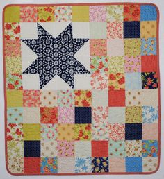 "Quilt - ""Aloha Star"". Bright contemporary, modern quit.100% cotton. Perfect for a baby or as a wall hanging to brighten up any room. Warm and Soft."