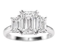 Emerald-Cut Three Stone Diamond Ring