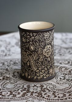 This is a lovely vase. Dark brown and cream in a wild flower design. Would also make an awesome utensil holder. I hand carved this design after