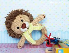 Lion baby rattle crochet pattern by Amigurumi Today