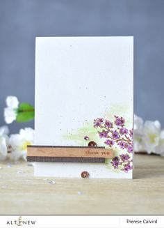 What a lovely card with cherry blossom background and sentiment stamped on a woodgrain bark cardstock.  Visit our blog to learn more. http://altenewblog.com/2016/11/17/stamp-focus-moments-time-video/
