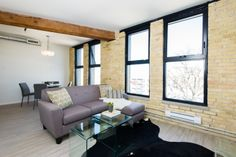 The PIONEER at District Condos - Loft style conversion condos featuring exposed brick, century old wood beams,and modern finishes. Great floor plan with lots of windows and space. Wood beam adds lots of character. Barn style door to master