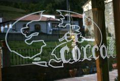 Logo El Corcal de Liébana en el espejo