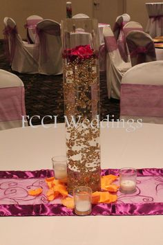 Tall vase with gold.  Wedding reception centerpiece.