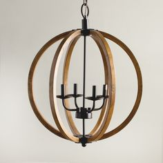 Rustic enough to please a Norse god while remaining perfect for the modernist with it's clean, open design, this chandelier's distressed wooden sphere is complemented by metal hardware. The candelabra bulbs add to its versatile appeal.