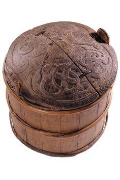 Viking era storage jar from Lillhärdal, Sweden. Carved dragons on the lid.