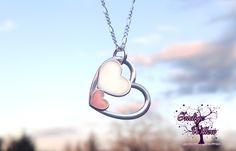 Three Hearts Breast Milk Pendant. I so want this for mother's day!!!