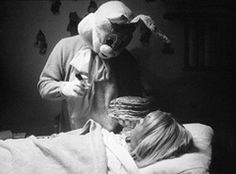 Perhaps my favorite. The child is paralyzed with fear as the psychotic Easter bunny looms over her with a hypodermic needle in one hand and a stack of pancakes in the other. Bunny Man, Bunny Suit, Rabbit Head, Bunny Rabbit, Evil Bunny, Creepy, Scary, Indie Films, Baby Bunting