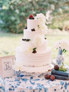 Floral + berry topped cake: http://www.stylemepretty.com/little-black-book-blog/2016/04/22/this-sapphire-ring-kicked-off-one-beautiful-blue-party/ | Photography: Katie Stoops - http://katiestoops.com/