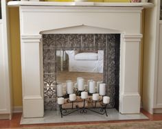 Faux fireplace with mirror and candles. This is happening.