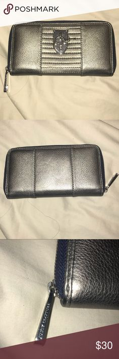 Juicy Couture - Silver Wallet Only used once! Authentic Juicy Couture wallet. Has no damages or stains and is in great condition! Juicy Couture Bags Wallets