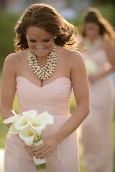 Blush bridesmaid dress, simple Calla Lily bouquet and classic pearls