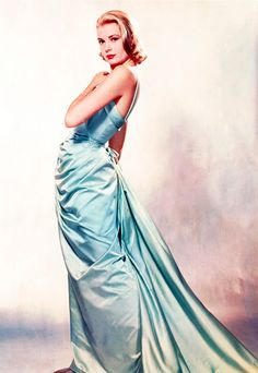 """1955, Grace Kelly Oscars Red Carpet Dress stunned all at the Academy Awards. It was ice-blue satin with a matching evening coat designed by Paramount costumer designer Edith Head who attended the ceremony as Kelly's date. The dress was created the premiere of the movie for which Kelly won, """" The Country Girl"""", and was cut from a bolt of $4,000 French Satin."""