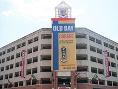 """Baltimore parking garage festooned with five-story Old Bay """"can"""" commemorating the ironic crab/seafood spice's 70th anniversary. I miss Maryland at times like this."""