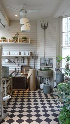 I would LOVE this floor in my new laundry room/mudroom with pale vintage green and true red pelargonium plants in pots. Reminds me of the little restaurant at Summer Hill Farm.....